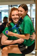 12 August 2019; Claire Melia, left, and Enya Maguire of the Ireland basketball bronze medallist squad on their return from the FIBA U20 Women's European Championships Division B Finals, held in Kosovo, at Dublin Airport in Dublin. Photo by Stephen McCarthy/Sportsfile