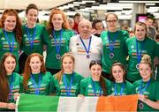 12 August 2019; Head coach Martin Conroy with members of the Ireland basketball bronze medallist squad on their return from the FIBA U20 Women's European Championships Division B Finals, held in Kosovo, at Dublin Airport in Dublin. Photo by Stephen McCarthy/Sportsfile