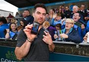 12 August 2019; Michael Darragh MacAuley of Dublin shows off the phone background of supporter Martina McHugh from Blessington, Co Dublin, right, during a meet and greet at Parnell Park in Dublin. Photo by David Fitzgerald/Sportsfile
