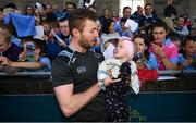12 August 2019; Jack McCaffrey of Dublin with Lana Kearns, age 10 months, from Palmerstown, Co Dublin during a meet and greet at Parnell Park in Dublin. Photo by David Fitzgerald/Sportsfile