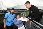 12 August 2019; Brian Fenton of Dublin signs an autograph for Shauna Morgan from Coolock and Jordan Fahey from Blanchardstown, Co Dublin during a meet and greet at Parnell Park in Dublin. Photo by David Fitzgerald/Sportsfile
