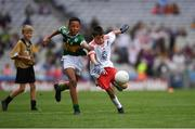 11 August 2019; Turlough Carr, St Francis, Barnesmore, Donegal Town, Donegal, representing Tyrone, and Declan Osagie, Scoil Mhuire, Banríon, Edenderry, Offaly, representing Kerry, during the INTO Cumann na mBunscol GAA Respect Exhibition Go Games during the GAA Football All-Ireland Senior Championship Semi-Final match between Kerry and Tyrone at Croke Park in Dublin. Photo by Ray McManus/Sportsfile