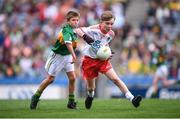 11 August 2019; Conor Bodkin, St. Patricks PS, Tuam, Galway, representing Tyrone, and Nathan Dunne, Scoil Bhride, Naas, Kildare, representing Kerry, during the INTO Cumann na mBunscol GAA Respect Exhibition Go Games at half-time of the GAA Football All-Ireland Senior Championship Semi-Final match between Kerry and Tyrone at Croke Park in Dublin. Photo by Stephen McCarthy/Sportsfile