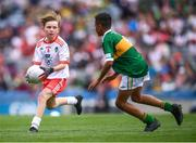 11 August 2019; Conor Bodkin, St. Patricks PS, Tuam, Galway, representing Tyrone, and Declan Osagie, Scoil Mhuire, Banríon, Edenderry, Offaly, representing Kerry, during the INTO Cumann na mBunscol GAA Respect Exhibition Go Games at half-time of the GAA Football All-Ireland Senior Championship Semi-Final match between Kerry and Tyrone at Croke Park in Dublin. Photo by Stephen McCarthy/Sportsfile