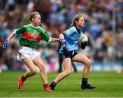 10 August 2019; Sarah Clarke, Farnham NS. Drumelis, Cavan, representing Dublin,  in action against Caoimhe Kelly, Mullaghrafferty, Carrickmacross, Monaghan, representing Mayo, during the INTO Cumann na mBunscol GAA Respect Exhibition Go Games during the GAA Football All-Ireland Senior Championship Semi-Final match between Dublin and Mayo at Croke Park in Dublin. Photo by Ray McManus/Sportsfile
