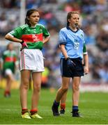10 August 2019; Holly O'Shea, Herbertstown NS, Herbertstown, Limerick, representing Mayo, and Maggie Holland, Rampark NS, Dundalk, Louth, representing Dublin,  during the INTO Cumann na mBunscol GAA Respect Exhibition Go Games during the GAA Football All-Ireland Senior Championship Semi-Final match between Dublin and Mayo at Croke Park in Dublin. Photo by Ray McManus/Sportsfile