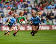 10 August 2019; Shelly Ryan, Ballyporeen NS, Cahir, Tipperary, representing Mayo, in action against Sarah Clarke, Farnham NS. Drumelis, Cavan, representing Dublin, during the INTO Cumann na mBunscol GAA Respect Exhibition Go Games during the GAA Football All-Ireland Senior Championship Semi-Final match between Dublin and Mayo at Croke Park in Dublin. Photo by Ray McManus/Sportsfile