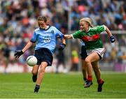 10 August 2019; Maggie Holland, Rampark NS, Dundalk, Louth, representing Dublin, in action against Lilly Murray, Ballymurray NS, Ballymurray, Roscommon, representing Mayo, during the INTO Cumann na mBunscol GAA Respect Exhibition Go Games during the GAA Football All-Ireland Senior Championship Semi-Final match between Dublin and Mayo at Croke Park in Dublin. Photo by Ray McManus/Sportsfile