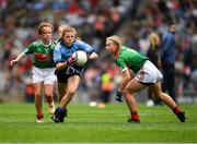 10 August 2019; Layla Stafford, Glynn NS Glynn, Wexford, representing Dublin, in action against Caoimhe Kelly, Mullaghrafferty, Carrickmacross, Monaghan, representing Mayo, and Lilly Murray, Ballymurray NS, Ballymurray, Roscommon, representing Mayo, during the INTO Cumann na mBunscol GAA Respect Exhibition Go Games during the GAA Football All-Ireland Senior Championship Semi-Final match between Dublin and Mayo at Croke Park in Dublin. Photo by Ray McManus/Sportsfile