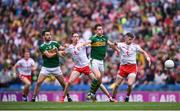 11 August 2019; David Moran and Jack Sherwood, left, of Kerry in action against Colm Cavanagh, left, and Richie Donnelly of Tyrone during the GAA Football All-Ireland Senior Championship Semi-Final match between Kerry and Tyrone at Croke Park in Dublin. Photo by Stephen McCarthy/Sportsfile