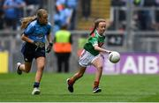 10 August 2019; Laura O'Shea, Herbertstown NS, Herbertstown, Limerick, representing Mayo, in action against Sophie English, Mount Anville PS, Stillorgan, Dublin, during the INTO Cumann na mBunscol GAA Respect Exhibition Go Games during the GAA Football All-Ireland Senior Championship Semi-Final match between Dublin and Mayo at Croke Park in Dublin. Photo by Piaras Ó Mídheach/Sportsfile