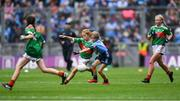 10 August 2019; Shelly Ryan, Ballyporeen NS, Cahir, Tipperary, representing Mayo, in action against Ellie McCarthy, St John's PS, Maghera, Derry, representing Dublin, during the INTO Cumann na mBunscol GAA Respect Exhibition Go Games during the GAA Football All-Ireland Senior Championship Semi-Final match between Dublin and Mayo at Croke Park in Dublin. Photo by Piaras Ó Mídheach/Sportsfile