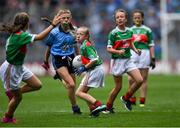 10 August 2019; Caoimhe Gollogly, Our Lady's & St. Mochua's PS, Derrynoose, Armagh, representing Mayo, in action against Pádraig Keenan, St Clare's PS 323, Cupar Street, Antrim, representing Dublin,  during the INTO Cumann na mBunscol GAA Respect Exhibition Go Games during the GAA Football All-Ireland Senior Championship Semi-Final match between Dublin and Mayo at Croke Park in Dublin. Photo by Piaras Ó Mídheach/Sportsfile