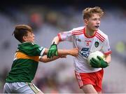 11 August 2019; Shane Mullarkey, Ballyroan Boys NS, Rathfarnham, Dublin, representing Tyrone, and James O'Malley, Lisnagry NS, Lisnagry, Limerick, representing Kerry, during the INTO Cumann na mBunscol GAA Respect Exhibition Go Games at half-time of the GAA Football All-Ireland Senior Championship Semi-Final match between Kerry and Tyrone at Croke Park in Dublin. Photo by Stephen McCarthy/Sportsfile