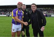 13 August 2019; Lee Chin of team Jim Bolger with the official match starter Tony McCoy, right, and referee Jimmy Barry-Murphy before the eighth annual Hurling for Cancer Research, a celebrity hurling match in aid of the Irish Cancer Society in St Conleth's Park, Newbridge. The event, organised by legendary racehorse trainer Jim Bolger and National Hunt jockey Davy Russell, has raised €830,000 to date to fund the Irish Cancer Society's innovative cancer research projects. The final score was: Jim Bolger's Best: 15, Davy Russell's Stars 15. St Conleth's Park, Newbridge, Co Kildare. Photo by Matt Browne/Sportsfile