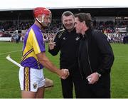 13 August 2019; Lee Chin of team Jim Bolger with the official match starter Tony McCoy and referee Jimmy Barry-Murphy before the eighth annual Hurling for Cancer Research, a celebrity hurling match in aid of the Irish Cancer Society in St Conleth's Park, Newbridge. The event, organised by legendary racehorse trainer Jim Bolger and National Hunt jockey Davy Russell, has raised €830,000 to date to fund the Irish Cancer Society's innovative cancer research projects. The final score was: Jim Bolger's Best: 15, Davy Russell's Stars 15. St Conleth's Park, Newbridge, Co Kildare. Photo by Matt Browne/Sportsfile