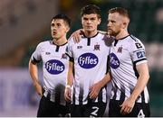 13 August 2019; Dejected Dundalk players, from left, Jamie McGrath, Seán Gannon and Seán Hoare following the UEFA Europa League 3rd Qualifying Round 2nd Leg match between Dundalk and SK Slovan Bratislava at Tallaght Stadium in Tallaght, Dublin. Photo by Stephen McCarthy/Sportsfile