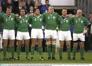 """11 October 2003; Ireland players, from left, Anthony Foley, Keith Gleeson, Reggie Corrigan, Victor Costello, Marcus Horan and Keith Wood stand together for """" Ireland's Call """" before the game. 2003 Rugby World Cup, Pool A, Ireland v Romania, Central Coast Stadium, Gosford, New South Wales, Australia. Picture credit; Brendan Moran / SPORTSFILE *EDI*"""