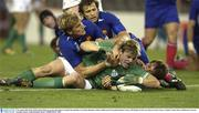9 November 2003; Brian O'Driscoll, Ireland, scores his sides third try despite the attentions of Aurelien Rougerie, Fabien Galthie and Christophe Dominici, France. 2003 Rugby World Cup, Quarter Final, France v Ireland, Telstra Dome, Melbourne, Victoria, Australia. Picture credit; Brendan Moran / SPORTSFILE *EDI*