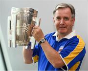 16 August 2019; Tipperary supporter Teddy Walsh, originally from Carrick on Suir, who has been living in Copenhagen for 40 years, with the Liam MacCarthy Cup at the GAA's Home for the Match stand in the arrivals hall at Dublin Airport. Photo by Ramsey Cardy/Sportsfile