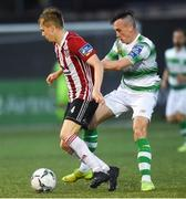 16 August 2019; Ciaron Harkin of Derry City in action against Aaron Greene of Shamrock Rovers during the SSE Airtricity League Premier Division match between Derry City and Shamrock Rovers at the Ryan McBride Brandywell Stadium in Derry. Photo by Oliver McVeigh/Sportsfile