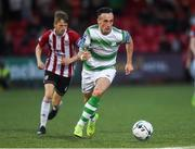 16 August 2019; Aaron McEneff of Shamrock Rovers in action against Ciaron Harkin of Derry City during the SSE Airtricity League Premier Division match between Derry City and Shamrock Rovers at the Ryan McBride Brandywell Stadium in Derry. Photo by Oliver McVeigh/Sportsfile