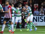 16 August 2019; Aaron McEneff of Shamrock Rovers, centre, celebrates with Greg Bolger and Aaron Greene after scoring his side's first goal during the SSE Airtricity League Premier Division match between Derry City and Shamrock Rovers at the Ryan McBride Brandywell Stadium in Derry. Photo by Oliver McVeigh/Sportsfile