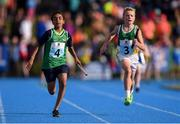 17 August 2019; Julian Mahango of Regional, Co. Limerick, left, and Alex Bagaall of Edenderry, Co. Offaly, compete in the Boys' U12 Relay Heats during Day 1 of the Aldi Community Games August Festival, which saw over 3,000 children take part in a fun-filled weekend at UL Sports Arena in University of Limerick, Limerick. Photo by Ben McShane/Sportsfile