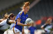 17 August 2019; Aishling Moloney of Tipperary in action against Gráinne O'Loughlin of Sligo during the TG4 All-Ireland Ladies Football Intermediate Championship Semi-Final match between Sligo and Tipperary at Nowlan Park in Kilkenny. Photo by Piaras Ó Mídheach/Sportsfile