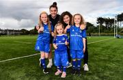 17 August 2019; Leinster players, Judy Bobbett, left, and Jenny Murphy with mascots from left, Sadhbh McKane, age 9, Tara McKane, age 5 and Caoimhe McKane, age 8 from Donore, Co. Meath prior to the Women's Interprovincial Rugby Championship match between Leinster and Connacht at Energia Park in Donnybrook, Dublin. Photo by Eóin Noonan/Sportsfile
