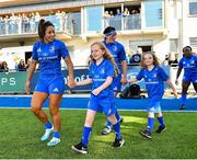 17 August 2019; Mascots, from left, Sadhbh McKane, age 9, and sister Caoimhe McKane, age 8, from Donore, Co. Meath, walk out with Leinster players Sene Naoupu and Lindsay Peat prior to the Women's Interprovincial Rugby Championship match between Leinster and Connacht at Energia Park in Donnybrook, Dublin. Photo by Seb Daly/Sportsfile