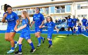 17 August 2019; Mascots, from left, Sadhbh McKane, age 9, Caoimhe McKane, age 8, and Tara McKane, age 5, from Donore, Co. Meath, walk out with Leinster players Sene Naoupu, Lindsay Peat and Linda Djougang prior to the Women's Interprovincial Rugby Championship match between Leinster and Connacht at Energia Park in Donnybrook, Dublin. Photo by Seb Daly/Sportsfile