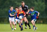 18 August 2019; Rory McDonald of St. Patricks, Co. Cavan, in action against Donal Early, left, and Ethan Kelly of Malahide, Co. Dublin, competing in the Boys/Girls/Mixed U10 Gaelic Football during Day 2 of the Aldi Community Games August  Festival, which saw over 3,000 children take part in a fun-filled weekend at UL Sports Arena in University of Limerick, Limerick. Photo by Ben McShane/Sportsfile