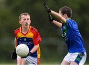 18 August 2019; Rory McDonald of St. Patricks, Co. Cavan, in action against Donal Early of Malahide, Co. Dublin, competing in the Boys/Girls/Mixed U10 Gaelic Football during Day 2 of the Aldi Community Games August  Festival, which saw over 3,000 children take part in a fun-filled weekend at UL Sports Arena in University of Limerick, Limerick. Photo by Ben McShane/Sportsfile