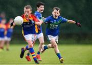 18 August 2019; Rory McDonald of St. Patricks, Co. Cavan, in action against Daniel Noonan of Malahide, Co. Dublin, competing in the Boys/Girls/Mixed U10 Gaelic Football during Day 2 of the Aldi Community Games August  Festival, which saw over 3,000 children take part in a fun-filled weekend at UL Sports Arena in University of Limerick, Limerick. Photo by Ben McShane/Sportsfile