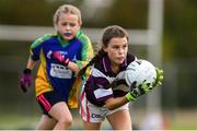18 August 2019; Orlagh McCarthy of Skibbereen, Co. Cork in action against Philipa Smith of Erne Valley, Co. Cavan, competing in the Girls U12 Gaelic Football during Day 2 of the Aldi Community Games August  Festival, which saw over 3,000 children take part in a fun-filled weekend at UL Sports Arena in University of Limerick, Limerick. Photo by Ben McShane/Sportsfile