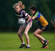 18 August 2019; Emma O'Donovan of Skibbereen, Co. Cork in action against Kyra Comaskey of Erne Valley, Co. Cavan, competing in the Girls U12 Gaelic Football during Day 2 of the Aldi Community Games August  Festival, which saw over 3,000 children take part in a fun-filled weekend at UL Sports Arena in University of Limerick, Limerick. Photo by Ben McShane/Sportsfile