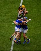18 August 2019; John McGrath, right, Ger Browne, Willie Connors, left of Tipperary celebrate, as a dejected Richie Leahy of Kilkenny sits on the field after the GAA Hurling All-Ireland Senior Championship Final match between Kilkenny and Tipperary at Croke Park in Dublin. Photo by Daire Brennan/Sportsfile