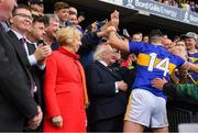 18 August 2019; Tipperary captain Séamus Callanan is congratulated by supporters as the President Michael D Higgins and his wife Sabina wait their turn before the presentation of the the Liam MacCarthy Cup after the GAA Hurling All-Ireland Senior Championship Final match between Kilkenny and Tipperary at Croke Park in Dublin. Photo by Ray McManus/Sportsfile