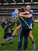 18 August 2019; John McGrath of Tipperary celebrates with manager Liam Sheedy following their side's victory during the GAA Hurling All-Ireland Senior Championship Final match between Kilkenny and Tipperary at Croke Park in Dublin. Photo by Seb Daly/Sportsfile