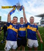 18 August 2019; Tipperary team mates, from left, Noel McGrath, Brian McGrath and John McGrath with the Liam MacCarthy cup following the GAA Hurling All-Ireland Senior Championship Final match between Kilkenny and Tipperary at Croke Park in Dublin. Photo by Stephen McCarthy/Sportsfile