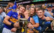 18 August 2019; Tipperary captain Séamus Callanan is congratulated by his mother Mary and dad John, sister Fiona, and his brother John also with the Liam MacCarthy Cup after the GAA Hurling All-Ireland Senior Championship Final match between Kilkenny and Tipperary at Croke Park in Dublin. Photo by Ray McManus/Sportsfile