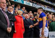 18 August 2019; Tipperary captain Séamus Callanan is congratulated by the President Michael D Higgins before being presented with the Liam MacCarthy Cup after the GAA Hurling All-Ireland Senior Championship Final match between Kilkenny and Tipperary at Croke Park in Dublin. Photo by Ray McManus/Sportsfile