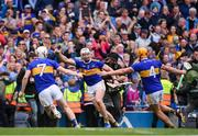 18 August 2019; Tipperary players, from left, Séamus Kennedy, Padraic Maher and Ronan Maher celebrate following the GAA Hurling All-Ireland Senior Championship Final match between Kilkenny and Tipperary at Croke Park in Dublin. Photo by Stephen McCarthy/Sportsfile