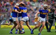18 August 2019; Tipperary players, from left, Séamus Kennedy, Ronan Maher, James Barry and Padraic Maher celebrate at the final whistle of the GAA Hurling All-Ireland Senior Championship Final match between Kilkenny and Tipperary at Croke Park in Dublin. Photo by Brendan Moran/Sportsfile