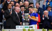 18 August 2019; Tipperary captain Séamus Callanan is presented with the Liam MacCarthy cup by Uachtaráin Cumann Lúthchleas Gael John Horan after the GAA Hurling All-Ireland Senior Championship Final match between Kilkenny and Tipperary at Croke Park in Dublin. Photo by Brendan Moran/Sportsfile