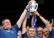 18 August 2019; Tipperary manager Liam Sheedy, second left, lifts the Liam MacCarthy cup with backroom staff, from left, coach Darragh Egan, coach Eamon O'Shea and selector Tommy Dunne, following the GAA Hurling All-Ireland Senior Championship Final match between Kilkenny and Tipperary at Croke Park in Dublin. Photo by Seb Daly/Sportsfile