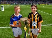 18 August 2019; Match Mascots Michelle Cash, Scoil Ruadháin, Tullaroan, Co. Kilkenny and Rory McLoughney, Ardcroney NS, Co. Tipperary bring out the Liam MacCarthy Cup prior to the GAA Hurling All-Ireland Senior Championship Final match between Kilkenny and Tipperary at Croke Park in Dublin. Photo by Seb Daly/Sportsfile