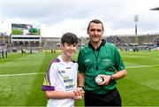 18 August 2019; Referee Patrick Murphy is presented with the match ball by Conor Lawless, Lisheenkyle NS, Athenry, Co. Galway, before the Electric Ireland GAA Hurling All-Ireland Minor Championship Final match between Kilkenny and Galway at Croke Park in Dublin. Photo by Piaras Ó Mídheach/Sportsfile