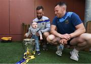 19 August 2019; James Barry, left, and Seán O'Brien of Tipperary with Liam Tomney, aged 1, the Liam MacCarthy Cup on a visit by the Tipperary All-Ireland hurling champions to Children's Health Ireland at Crumlin in Dublin.  Photo by Sam Barnes/Sportsfile